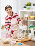 Woman cooking at home kitchen. Healthy food concept - 195302035