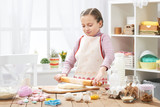 Girl cooking in home kitchen, making dough, healthy food concept - 195302079