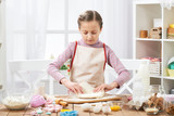 Girl cooking in home kitchen, making dough, healthy food concept - 195302086