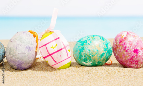 Easter on beach background. Eggs on the