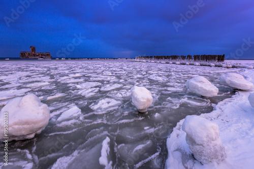 Foto op Canvas Purper Frozen coastline of Baltic Sea in Gdynia at dusk, Poland