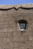 Semi-abstract thatched roof and window - 195307488