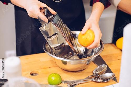 Woman peeling orange