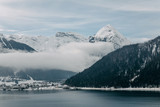 beautiful scenic landscape with snow-covered mountains and majestic mountain lake in austria