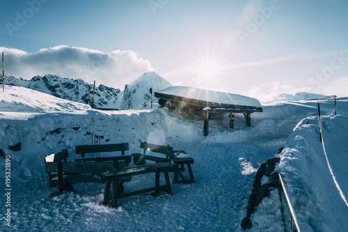 Foto op Plexiglas Antarctica 2 empty wooden benches in snow-covered mountains, mayrhofen ski area, austria