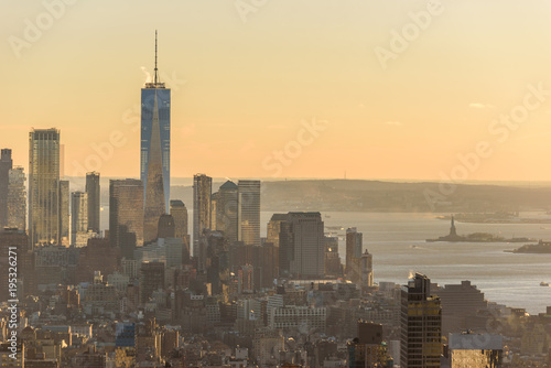 Foto op Aluminium New York New York City - USA. View to Lower Manhattan downtown skyline with famous Empire State Building and One World Center and skyscrapers at sunset.
