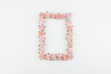 Pink and orange paper flowers square wreath on white background with copy space - 195328811