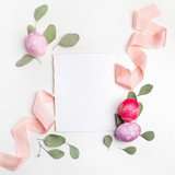 Stylish Frame background with easter eggs with copy space for text. on white background. Flat lay, top view. Easter concept.