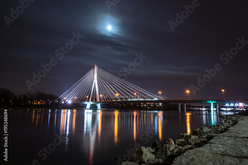 Aluminium Bruggen Swietokrzyski bridge over the Vistula river at night in Warsaw, Poland