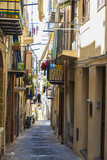 Street of the old town of Cefalu in Sicily, Italy