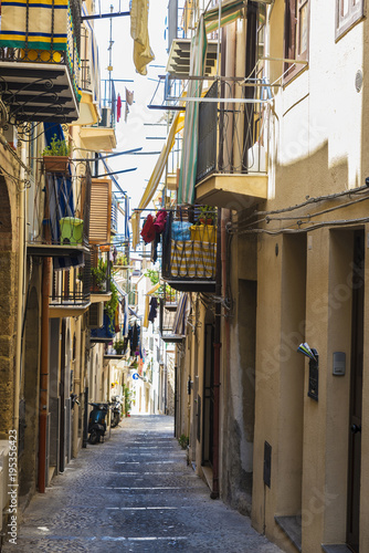 Fototapeta Street of the old town of Cefalu in Sicily, Italy