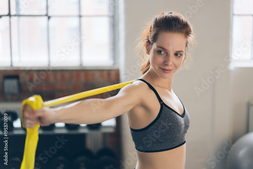 Fotobehang Fitness Young shapely woman doing exercises in a gym