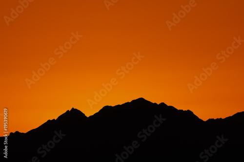 Deurstickers Baksteen mountain silhouette in the Negev desert in Israel at sunset sunrise
