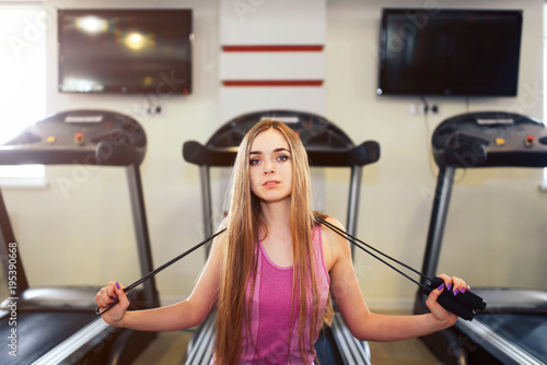 Long hair pretty girl training in the gym