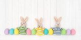 Easter decoration eggs funny bunnies wooden background - 195399234