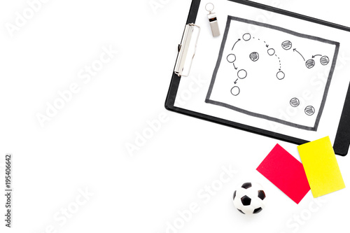 Sport judging concept. Soccer referee. Tactic plan for game, football ball, red and yellow cards, whistle on white background top view copy space