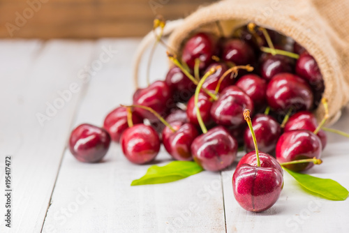 Fotobehang Kersen Fresh Cherry from farm, sweet and sour fruit, wooden table background