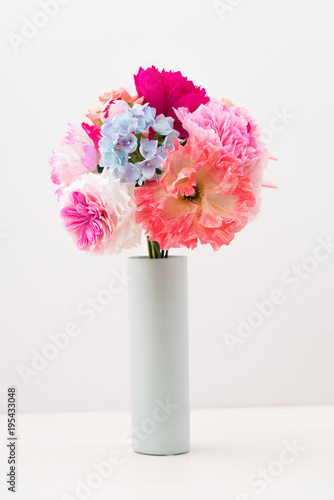 Staande foto Klaprozen Crepe paper flower bouquet with peonies, hyacinth, garden rose and poppies in a vase