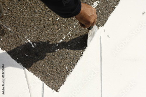 Aluminium Thailand white paint being applied to a new road surface