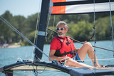 handsome mature man sailing - 195443086