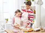 Mother and daughter cook at home. make the dough for buns - 195452491