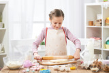 Girl cooking in home kitchen, making dough, healthy food concept - 195452644