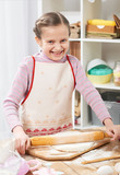 Girl cooking in home kitchen, making dough, healthy food concept - 195452688
