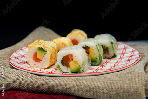 In de dag Sushi bar Japanese food Sushi Roll Maki of Salmon and avocado