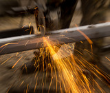 Sparks from metal cutting at the construction site - 195463455