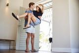 Man Carries Woman Over Threshold Of Honeymoon Rental - 195472606