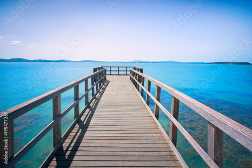 Plexiglas Pier Pier or jetty, Passignano sul Trasimeno on the Trasimeno lake, Umbria Italy.