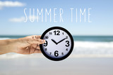 text summer time and man with a clock on the beach