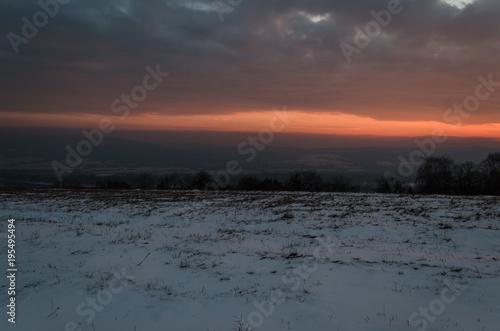Fotobehang Strand winter beauty sunset over hills