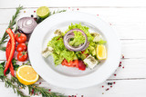 Greek Salad from Fresh Vegetables. On a wooden background. Top view. Copy space. - 195498437