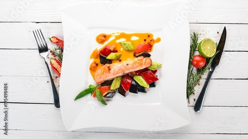 Fotobehang Steakhouse Baked Salmon Steak with Vegetables. On a wooden background. Top view. Copy space.