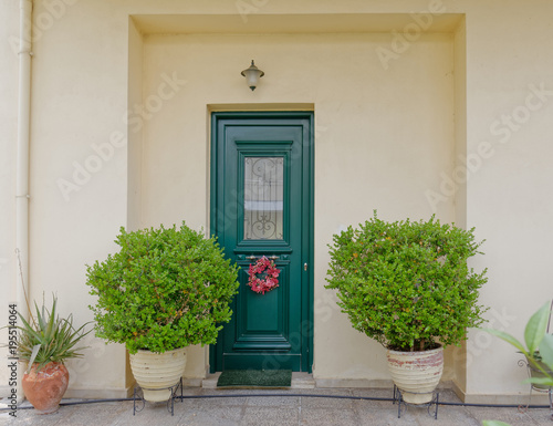 Athens Greece, cosy house entrance with green door and plants