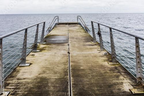 Pier and the winter sea, depressive winter view