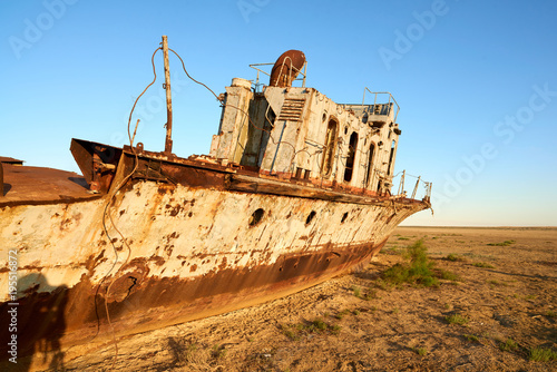 Fotobehang Schipbreuk Abandoned ships Aral Sea. The Aral Sea is a formerly un salt lake in Central Asia. The Aral Sea was an endorheic lake lying between Kazakhstan in the north and Uzbekistan in the south.