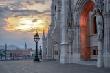 Fragment of Budapest Parliament building with stone carving and entrance gate at sunset - 195549826