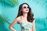 Portrait beauty sexy asian model with perfect face wearing a sunglasses and elegant bikini on palm tree shadow background. - 195585405