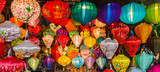 many colors of silk lanterns lit up at night - 195591692