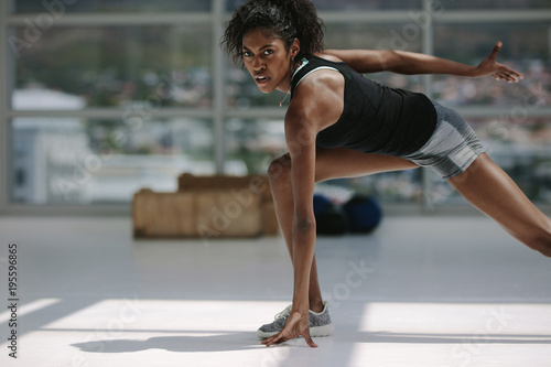 Healthy african woman working out in gym