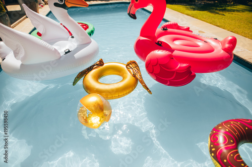 Papiers peints Kiev Colorful inflatable toys floating in a pool