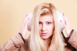Blonde woman in winter earmuffs and jacket. - 195605632