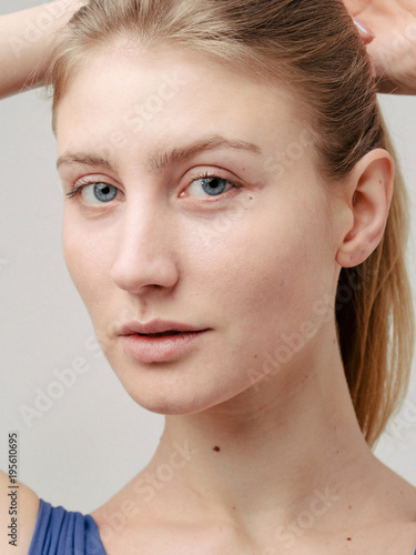 Blue eyed blond woman model posing to camera in studio. Professional photoshoot session. © RZ Images
