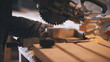 Worker carpenter figuring wooden board before circular saw sawing - 195614692