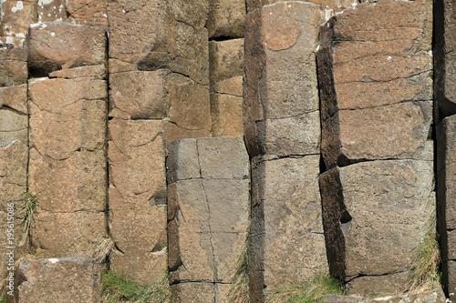 Tuinposter Baksteen muur naturalne pionowe bloki skalne