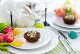 Beautiful table setting with crockery and flowers for Easter celebration - 195635690