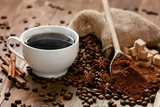 Cup Of Coffee And Coffee Beans On Table. - 195638006