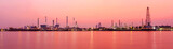 Panorama view of Oil refinery at the river in sunrise time
